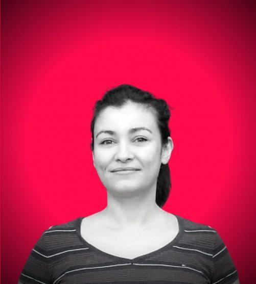 Ilknur Demirkoparan headshot against hot pink background